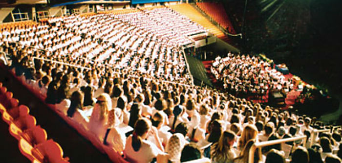 10,000 identically-dressed homsechoolers. That's normal. (I'm the one in the navy and white). 2002. Image: IBLP.org