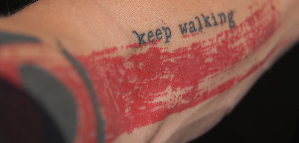 <strong>Keep Walking</strong> <br/><br/> <em>Like the words scrawled across my chest, this one splashed down my left arm is all red and black and full of hope. I need to tell you a story.</em><br/><br/>